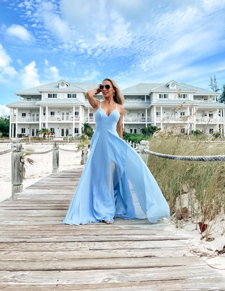 Blue maxi dresses are so great for beach vacations and summer blue skies. The floatier the better and this light blue gown has a cute criss cross back and sexy leg slit (shown below in red but links to blue and red). Would also make a great summer bridesmaid dress. Taken at the beach house Providenciales   #LTKstyletip #LTKtravel #LTKwedding  #LTKstyletip #LTKwedding