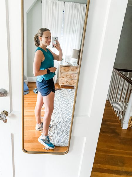 I love this cropped workout top, because it's A little bit loose, which I feel like looks cute with biker shorts. These are my go to running shorts for the summer because they decrease chafing #runningclothes #workoutclothes  #LTKfit #LTKstyletip