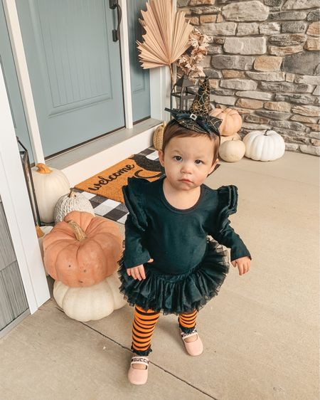 The cutest little witch I ever did see 🔮🕸 #spookyseason Her easy toddler costume is linked in the @shop.LTK app! Love this headband hat and the tights are actually a thicker knit that will keep her warm   #liketkit #ltkfamily #witchcostume #littlewitch #halloweencostume #babywitch #fallporchdecor #halloweenfun #halloween #easycostume #amazonfinds #amazonfashion #witchvibes #toddlercostume #fallporch #falldecor #frontporch #toddlerfashion #toddlergirl #kidscostume #witch #ltkholiday #ltkseasonal