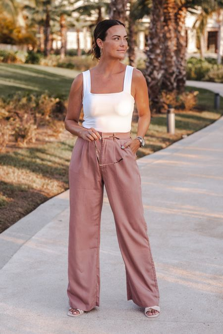 this square neck bodysuit is only $39 and available in 5 colors —I'm wearing a size small, and these high waisted pants are under $100 and run TTS.   #LTKtravel #LTKunder50 #LTKunder100
