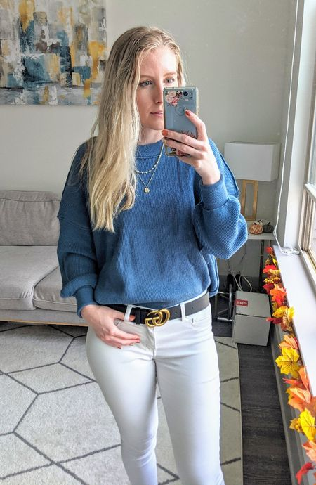 Add this Amazon sweater to your fall wardrobe! I tucked this oversized blue sweater into a pair of white jeans and added a black belt to create this easy fall look. 🍁 Pair with gold and black jewelry to elevate your look!   #LTKSeasonal #LTKstyletip #LTKunder50