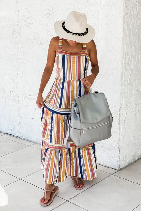 """Freshly Picked diaper bag that converts from a shoulder bag to a backpack! Mine is in the color """"Stone."""" Holds everything I need for my toddler. Great baby shower gift or addition to your baby gear. Available in so many other colors and in a mini size too! Flip flops from Old Navy. Dress from LOFT.  #LTKsalealert #LTKstyletip #LTKbaby"""