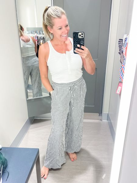 Love these striped wide leg beach pants with this $8 button tank top. Size small in both. Target style summer outfit ideas white tank swim cover up   #LTKunder50 #LTKstyletip #LTKSeasonal