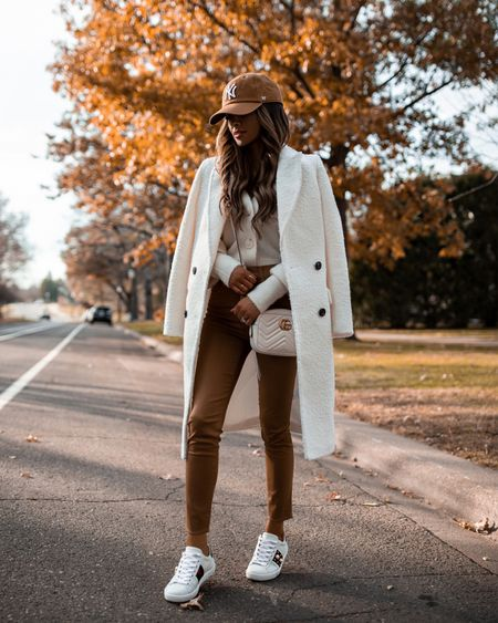 Fall casual outfit ideas  Joe's jeans camel coated denim  Express white coat  Gucci Ace sneakers  Gucci white marmont bag  NY Yankees cap   #LTKshoecrush #LTKstyletip #LTKunder100