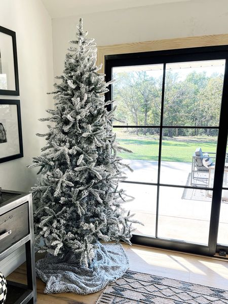"""This @walmart Christmas tree is a good one! It's 7'.5"""" tall and less than $200. No, I'm not decorating for Christmas…yet, but I needed to know if this tree was as good in person as it looked online 🙌🏽.   #LTKSeasonal #LTKhome #LTKHoliday"""