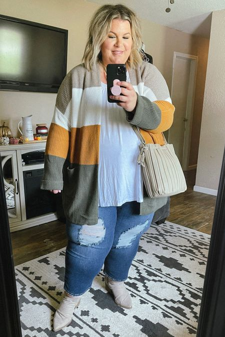 This plus size cardigan and these plus size jeans are have been top sellers! They make the most perfect plus size outfit and would be great as an outfit for family photos! Cardigan runs oversized, jeans are true to size.   #LTKunder50 #LTKSeasonal #LTKcurves
