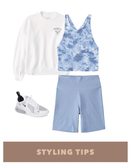 bike shorts paired with a cross-back tank , a crew sweatshirt and white sneakers makes a cute workout outfit. Shop my daily looks by following me on the LIKEtoKNOW.it shopping app  http://liketk.it/3hpRH #liketkit @liketoknow.it #LTKcurves #LTKsalealert #LTKstyletip #LTKtravel #LTKunder50 #LTKunder100 #LTKSeasonal #LTKshoecrush #LTKfit   Biker shorts outfit | summer outfits | summer fashion | activewear | spring outfit | shorts outfit women | tank tops | tank top summer | sneakers outfit | sneakers for women | summer outfits women | summer tank tops | Abercrombie | Abercrombie & Fitch | Nike sneakers | sneakers for gym | athleisure | sports bra