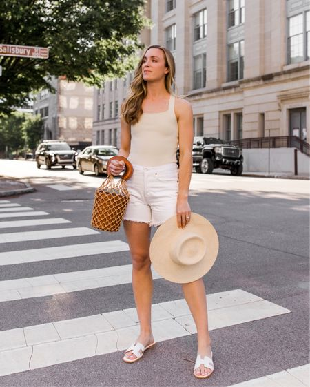 """Summer weekend outfit with my favorite affordable bodysuit and white mom shorts. Everything runs true to size—the bodysuit isn't too short on me and I'm 5'9"""" ✨ Similar items I love linked!  bodysuit outfit, neutral bodysuit, beige bodysuit, casual summer outfit, neutral summer outfit, bodysuit with shorts, white cutoffs, agolde Parker white, summer hats, casual summer look, cute summer looks, Natalie Yerger http://liketk.it/3fJz3 #liketkit @liketoknow.it"""