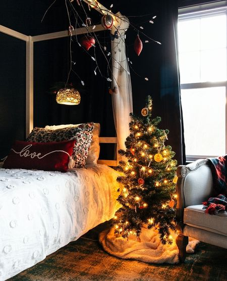 My kids' room is all decked out for Christmas and we're OBSESSED with this red tassel holiday pillow from Target and the set of flannel holly Christmas sheets. Plus? Their modern canopy bed is the perfect place to hang all the fairy lights.  #LTKhome #LTKkids