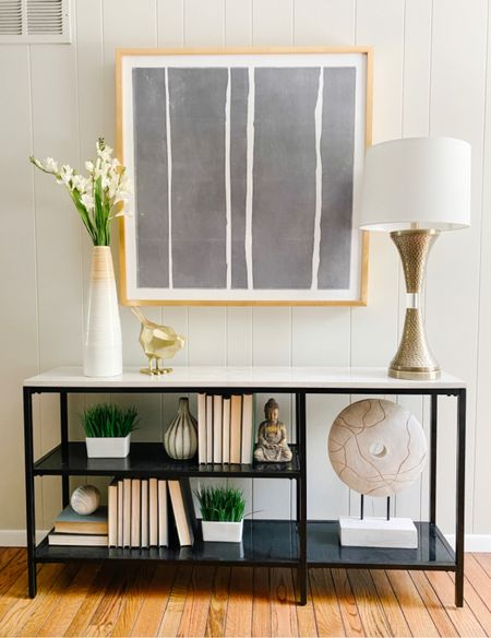 Fun and eclectic styling on this modern black and marble console table.  Shelf accessories, console styling, living room decor, dining room decor, accessories, gold lamp, Buddha sculpture, decorative objects  #LTKhome