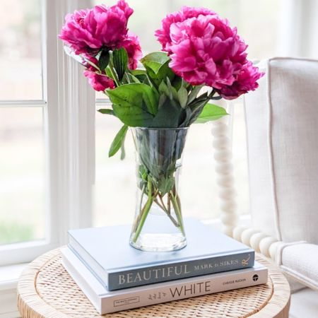 Peonies and hydrangeas are my two absolute favorite flowers and I couldn't be happier that peony season has arrived! My spindle chair, which I've linked here is currently almost 20% off!   @liketoknow.it @liketoknow.it.home #liketkit #LTKhome #LTKsalealert #LTKfamily http://liketk.it/3g49T  spring decor, spring home decor, summer decor, summer decorations, summer home decorations, coastal decor, beach house decor, beach decor, beach style, coastal home, coastal home decor, coastal decorating, coastal house decor, blue and white decor, home accessories decor, coastal accessories, coastal living room decor, coastal family room, living room decor, sunroom decor, sunroom furniture, spindle chair, neutral arm chair, serena & lily dupe, serena and lily dupe, arm chair, side chair, living room decor, living room ideas, neutral living room, neutral living rooms, neutral living room chairs, neutral home decor, cane, seagrass, rattan, coastal modern living room, rattan table, rattan table side, rattan side tables, side tables, wicker tables, living room side tables, bedroom tables side, bedroom side tables, water hyacinth tables, side tables Target,  coffee table books blue, coffee table books coastal, blue and white coffee table books