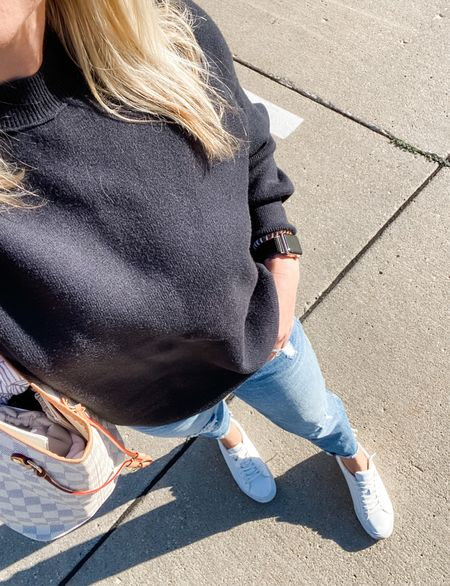 Feels like fall today and I'm very ok with it 🍁🍂 I got this sweater in last week and I guarantee it will be in a constant rotation when the weather stays cool! It's a really thick and stretchy material with side slits (I'll have to take a mirror picture but I'm never home anymore #momlife 😆). And breaking my favorite white sneakers out for the season today! Make sure you size down one size.   #sweater #denim #boyfriendjeans #jeans #sneakers #whitesneakers #lv #designer #kutfromthekloth #style #outfit #ootd #abercrombie #af   #LTKSeasonal #LTKunder100 #LTKstyletip