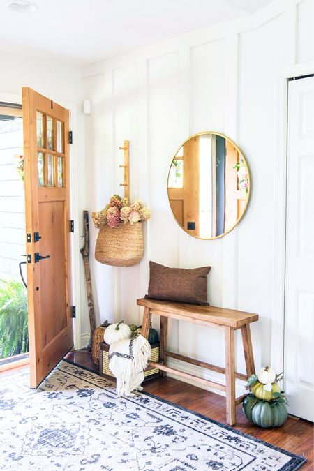 So much fall goodness is happening today over here! 🍂😁 . I showed this view in my stories yesterday as I worked with @walmart #ad to spruce up my entryway for fall! I love mixing modern pieces like this brass mirror with vintage items like this look-a-like bench. Pop in a few faux pumpkins and a basket of dried hydrangeas and she's done. 👏🏻  . Then, today in stories I'm joining up with some friends as part of a Fall In Love with your home story hop! And on the blog, I've got my second fall home tour. So. Much. Fall. 😉 Head to stories for all of it! #fromhousetohaven #walmarthome . . You can shop my entryway decor from @walmart with the @shop.ltk app!   #LTKhome #LTKunder50 #LTKSeasonal