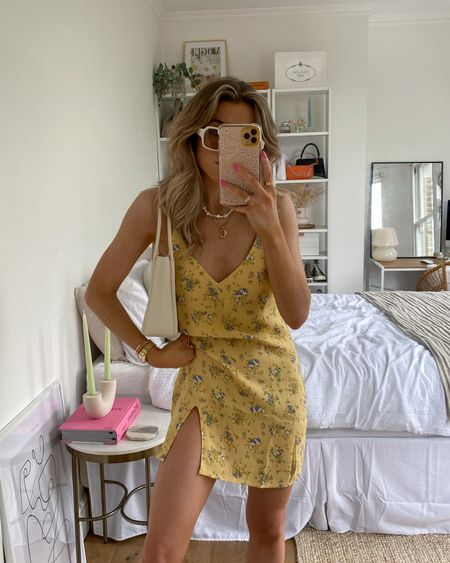 This reformation floral dress is perfect for the summer heatwave! Teamed with a pair of balenciaga chunky trainers for an easy summer look!   Use code CHARLOTTEO10YT for 10% off at farfetch     #LTKsalealert #LTKeurope #LTKSeasonal