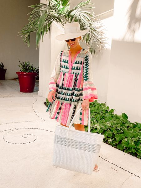 This DRESS. Perfect for a coverup at the pool, with sandals for a Saturday around town or with wedges for a fun date night. Beautiful quality and gorgeous colors. 💕🌴 I'm in an XS! (Hat is the Ibiza wide brim from Artesano and bag is from the resort we are staying at!)