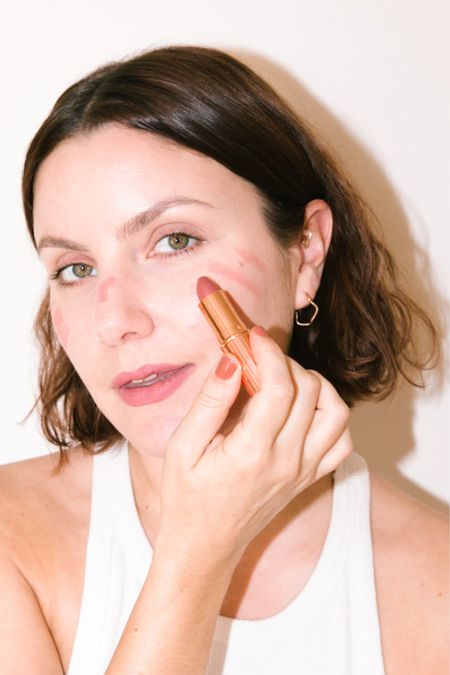 using my favourite Charlotte Tilbury Pillow talk on both lips and cheeks