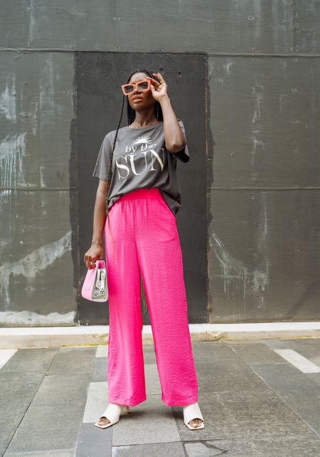 Casual lunch outfit. Vintage By the sun graphic tee, pink crepe wide leg pants, cream square toe heels and pink cat eye sunglasses.   #LTKunder50 #LTKstyletip #LTKunder100