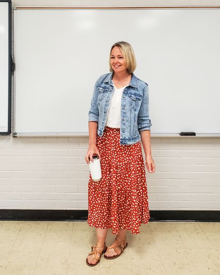 Casual everyday spring teacher outfit featuring a ruffled tiered floral midi maxi skirt, white v neck tee, denim jacket, and strappy flat sandals #ruffleskirt #midiskirt #maxiskirt #floralskirt #denimjacket #whitetee #strappysandals #summer #teacher #petite #everyday #spring #tieredskirt http://liketk.it/3f36D @liketoknow.it #liketkit