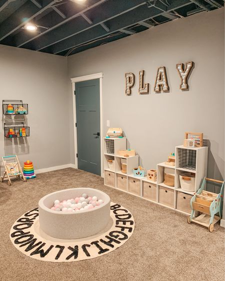 Playroom refresh ✔️#toddlermomlife Keeping up with reorganizing toys is no joke! Sharing Ellie's current favorites on my stories today. She is almost 13 months! All basement #playroom details are linked on @liketoknow.it and you can find them on my blog 🧸 http://liketk.it/3foeb   Download the LIKEtoKNOW.it app to shop this pic via screenshot! @liketoknow.it.home @liketoknow.it.family  #liketkit #LTKhome #LTKfamily #ballpit #amazonfinds #targethome #woodentoys #playroomstorage #mommyblogger #playroomorganization #LTKkids  - - - - - - #playroomideas #playroomgoals #basementceiling #playroominspo #playroomdecor #playtolearn #momblogger #toddlerplayroom #toyorganization #toddlerroom #kidsroomdecor #alphabetrug #playroomdesign #modernfarmhouse #playtime #farmhousedesign #farmhousedecor #playspace #hellotravelblog   Cube organizer. Toddler toys. Wooden toys. Play sign. Play letters. Playroom decor. Playroom organization.