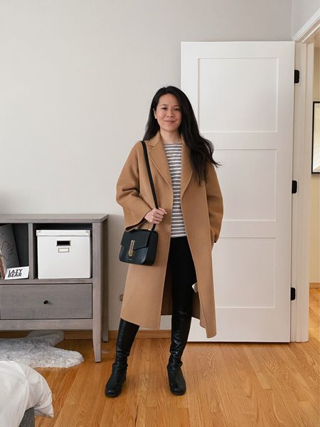 It's solidly coat season 🥶 This Curated Classic Camel Coat in a double faced wool / cashmere blend is staple, so easy to layer! Paired here with my 5050 over-the-knee boots and Breton long sleeved tee.   #LTKworkwear #LTKitbag