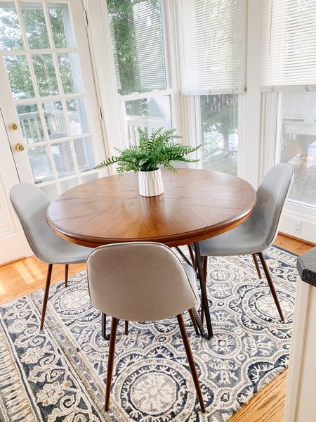 Small round eat in kitchen table and chairs.  Wood table, round dining table, gray upholstered chairs, small space kitchen, rustic table  #LTKhome