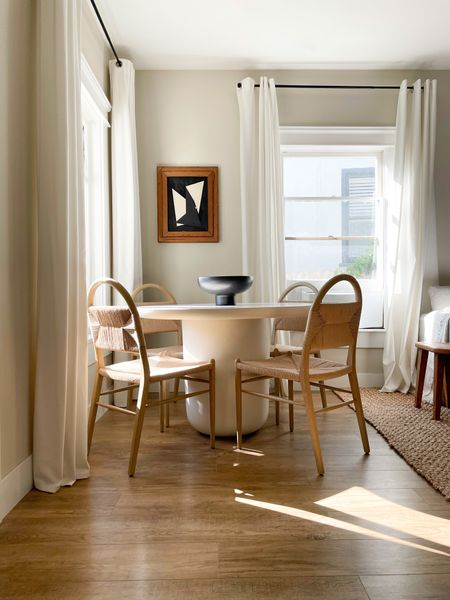 Minimal, modern organic dining room, with concrete table and curved natural fiber and wood chairs.   #LTKhome