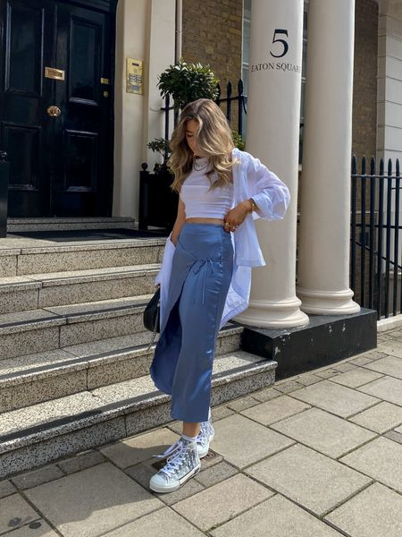Can't beat a satin skirt In the gal season! I've teamed this satin skirt with a lil white vest and an oversized shirt! Finished off with a pair of dior sneakers     #LTKeurope