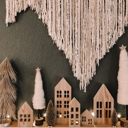 What?!? A new post?! It's been a while but this Christmas Village I'm working on is making me all gitty inside! I can't wait to show you my vision for the rest of the wall. I never thought I'd send a text asking someone to teach me how to weld but today was the day! 🤣 Just imagine some wooden boho snowflakes mixed in with some small golden metal flakes hanging against that deep green!! Can you see it??? 😍  . . . . Screenshot this pic to get shoppable product details with the LIKEtoKNOW.it shopping app  http://liketk.it/319dz #liketkit @liketoknow.it @liketoknow.it.home