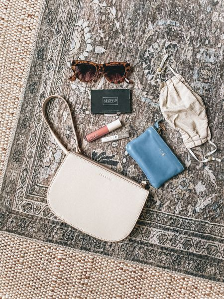 what I carry in my wedding guest clutch - small leather clutch, wallet, hydrating lip tint, sunglasses, face mask, blotting papers   #LTKwedding #LTKitbag #LTKstyletip