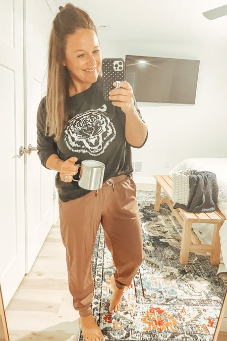 Perfect rainy day 'fit… best joggers & a comfy Tiger tee! Hot Yeti coffee [not!] optional! Add these pants to cart ASAP. They can be worn up or down and are the comfiest! http://liketk.it/3jJfw #LTKunder50 #LTKstyletip #liketkit @liketoknow.it