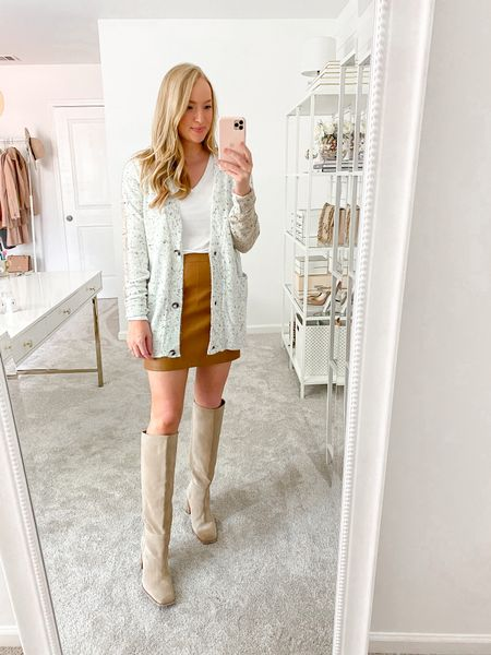 Love this color blocked button down cardigan. Wearing a small and found it in stock layered under a great long sleeve basic white tee!