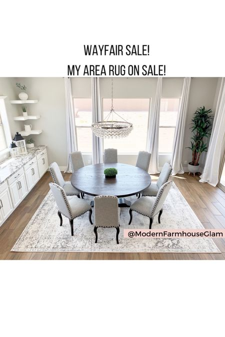 Neutral area rug, black and white distressed rug, dining room rug, round Farmhouse dining tables, crystal chandelier, curtains, dining room chairs, modern farmhouse Glam  #LTKhome #LTKsalealert