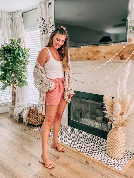 Amazon prime day sale - pink shorts (sized up). Quilted sandals - tts (wearing #1 light khaki color). Oversized knit cardigan - tts. Bodysuit - tts.   #LTKsalealert #LTKstyletip #LTKunder50