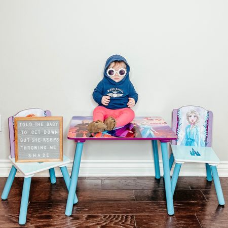 Told the baby to get down, but she keeps throwing me SHADE 😎  Monroe is one busy baby, but don't worry... we definitely don't let her sit on tables unsupervised. We watch her close so she doesn't get into any shady business 😂  With an all sister gang at our house, Frozen is definitely a fave at our house. I got the girls this sweet little @deltachildren table (includes a bookshelf too) for the playroom & it's a hit. I linked it plus baby Roe's look on @liketoknow.it down to her leopard moccasins. #liketkit http://liketk.it/36uUJ #LTKbaby #LTKkids