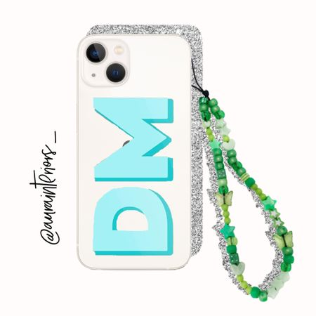 """Am I more excited for my new iPhone 13 mini or my custom 90s beaded phone loop?! 🦋🌿 Under $12 including personalization! I added the word """"dreamer"""" to mine ☁️   #iphone13 #iphone13mini iPhone 13 mini case, iPhone 13 case, iPhone mini case, iPhone monogram case, iPhone initial case, clear iPhone 13 mini case, monogrammed iPhone 13 case, monogram iPhone 13 case, initial iPhone 13 case, iPhone 13 mini starlight, iPhone 13 starlight, 90s phone strap, 90s phone loop, beaded phone strap, beaded phone loop, iPhone strap, iPhone loop, loopy case, iPhone bracelet, iPhone charm, phone charm, beaded phone charm, beaded iPhone charm, nineties phone strap, nineties phone loop, Kendall Jenner phone strap, Kendall Jenner phone loop, hands free iPhone, iPhone keychain, iPhone holder, phone loop, phone bracelet, iphone aesthetic, blue green iphone, blue monogram case, turquoise monogram case, green phone strap, green phone loop, green iPhone strap, green iphone loop, beaded iPhone loop, beaded iphone strap, custom phone case, custom phone loop, custom phone strap, green beaded iPhone, teal monogram case, blue initial case, mint initial case, turquoise initial case, mint monogram case, teal initial case, mint clear iPhone 13 case, clear iPhone 13 case, clear iPhone 13 monogram case, clear iPhone 13 initial case, iPhone mini essentials, iPhone mini must haves, iPhone 13 mini accessories    #LTKunder50"""