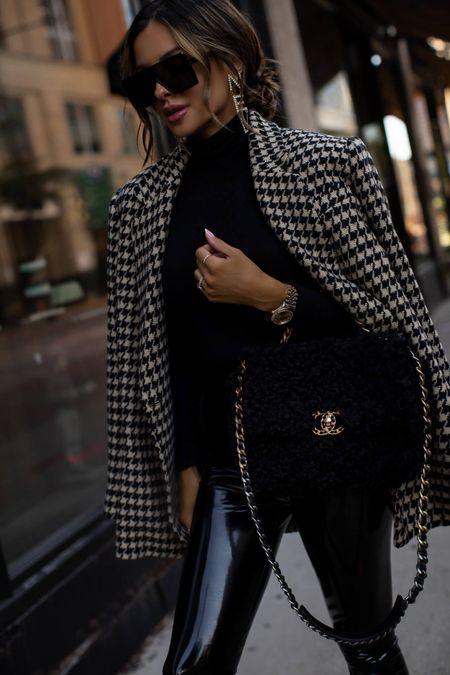 Fall outfit ideas  Commando patent leather leggings wearing an XS Commando black bodysuit  Anine Bing houndstooth blazer  Chanel Blazer  Chanel shearling bag  AllSaints combat boots  #fallfashion #datenight  #LTKSeasonal #LTKstyletip #LTKworkwear