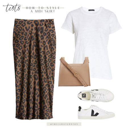 Whit tee, leopard midi skirt, tan handbag, white leather Veja sneakers  #LTKstyletip #LTKtravel #LTKshoecrush