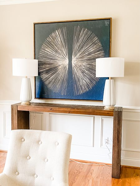 Love the navy artwork next to the wood console table and white table lamps.  Console style, dining room decor, large art, white lamps, home decor, navy and white art  #LTKhome