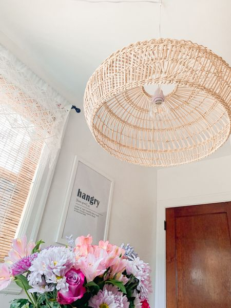 """The boho pendant of my dreams 🤩 This 23"""" diameter woven pendant is the perfect size for my 42"""" round dining table! Only $69.99!  This fixture can be hardwired or plug-in. I installed it myself [plug-in] in less than 10 min. It was the perfect finishing touch to my dining nook 🌸   Shop my daily looks by following me on LIKEtoKNOW.it!! http://liketk.it/39N5e #liketkit @liketoknow.it @liketoknow.it.home #LTKunder100 #LTKSeasonal #LTKhome    boho chandelier, boho dining nook, boho dining room, boho pendant, woven pendant, woven chandelier, rattan pendant, rattan chandelier, bamboo pendant, bamboo chandelier, hangry print, hangry art, hangry kitchen, boho curtains, macrame curtains, macrame valance, boho valance, white window valance, white valance, white boho curtains, cream valance, cream window valance, cream boho curtains, cream macrame curtains, cream macrame valance, orb pendant, orb chandelier, 42"""" round dining table, 42"""" round dining table chandelier, 42"""" dining table pendant, 42"""" dining table chandelier, dining nook chandelier, dining nook pendant, cane pendant, cane chandelier, world market bamboo open weave orb pendant, world market woven pendant, world market bamboo pendant, boho pendant non hardwired, plug in pendant, plug in chandelier, non hardwired pendant, non hardwired chandelier, renter friendly pendants, renter friendly chandelier, apartment friendly pendant, apartment friendly chandelier, boho island pendant, woven island pendant, 24"""" pendant, 24"""" chandelier, pendant short ceilings, chandelier short ceilings, light bamboo shades, light bamboo blinds, light wood blinds, light wood shades, light woven wood blinds, light woven wood shades, dining nook ideas, small dining nook, dining nook white walls, dining room white walls, led round bulb, led round halogen bulb, large round bulb, large round Edison bulb, led Edison bulb, large woven chandelier, large woven pendant, 2' diameter pendant, 2' diameter chandelier, large round chandelier, large round penda"""