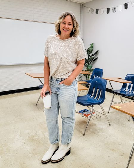 Casual everyday sequin sequined teacher outfit featuring a sparkly t-shirt tee, loose straight jeans, and white studded Chelsea boots #sequined #sequins #sparkle #loosejeans #straightjeans #chelseaboots #studdedboots #whiteboots #Casual #sparkles #teacher #mom #weekend #holiday #Friday #party http://liketk.it/3ogY4 @liketoknow.it #liketkit