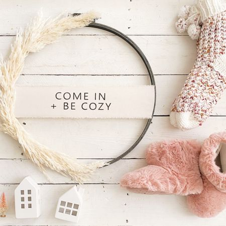 Come in + be cozy! Avri and I are loving wearing our  cozy slippers while we deck the halls for Christmas 🎄 They are both on sale for $7 and the pampas wreath is on sale in the Etsy shop. (Link in stories and bio) You can instantly shop my looks by following me on the LIKEtoKNOW.it shopping app @liketoknow.it http://liketk.it/32JO8 #liketkit #LTKgiftspo #LTKhome #LTKfamily @liketoknow.it.family @liketoknow.it.home