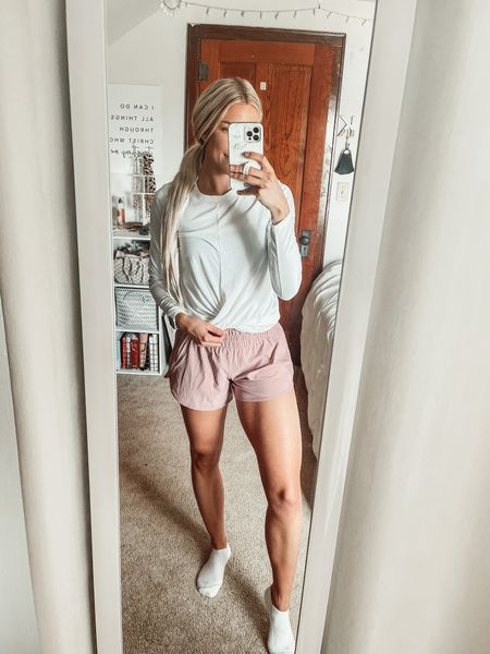 Today's gym OOTD 🏋️♀️  Wearing a size small in this affordable old navy long sleeve and size 8 in lululemon tracker shorts   #LTKunder50 #LTKunder100 #LTKfit