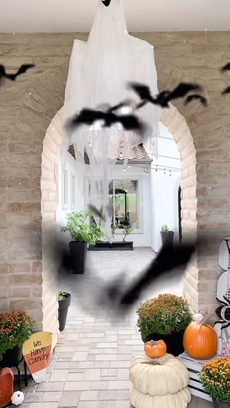 """I added some ghosts and a giant spider and web to my outdoor Halloween/Fall porch & courtyard!👻🕸🕷 Head to my stories to see the short video of it all! I think by the time I get it """"completed,"""" it will be time to put it away and start Christmas haha! Anyone else feel like that? I'm always finding new fun Fall things that I HAVE to have and it's never done.  This time of year is so much fun! Do you like decorating for Fall or Christmas more?   These pumpkins are all fake! They look so realistic? Some of them are pricey but worth it for those of us who use them year after year. The ones by my iron front door or more affordable. All linked below.  #falldecor #halloweendecor #halloweendecorations #outdoorpumpkins #joannagaines #halloween2021 #outdoorhalloween #modernfarmhouseglam #falldecorations #falldecorating #halloweendecorating #mybhg #mybhghome #ltkhome #targetfalldecor #pumpkinseason #mydecorvibe #itsfallyall #spookycute #homedecor #interiordesigninspo #americanfarmhousestyle #countrylivingmagazine #modernfarmhouse #farmhousefall #fallfarmhouse #frontporch #frontporchdecor #fallfrontporch #cozyhome   #LTKHoliday #LTKhome #LTKSeasonal  #LTKhome #LTKSeasonal #LTKHoliday"""