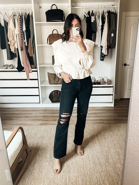 Nordstrom Try on!   I'm in the 29 of the Agolde jeans. They are 100% cotton, no stretch so I always size up. They stretch with wear but not in a whole size kind o a way. Fit is more of a straight leg than a true flare. It's tighter at the hips / waist.   I'm in the medium of this top. It's wayyyy cuter in person than online! I don't find the shoulders to be as bold. It's shorter than I was expecting at the peplum but that's my only complaint. Non-sheer.