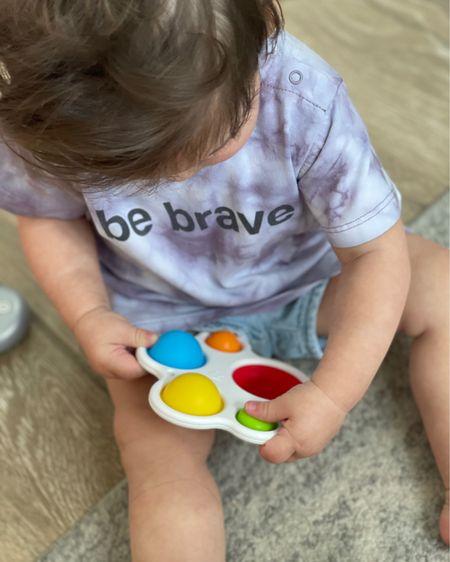 Sensory toy featuring silicone bubbles built into a sturdy plastic frame. Encourages fine motor skills, sensory exploration, cause-effect learning. #Toddlertoys http://liketk.it/3gPH0 #liketkit #LTKbaby #LTKkids #LTKfamily @liketoknow.it.family @liketoknow.it
