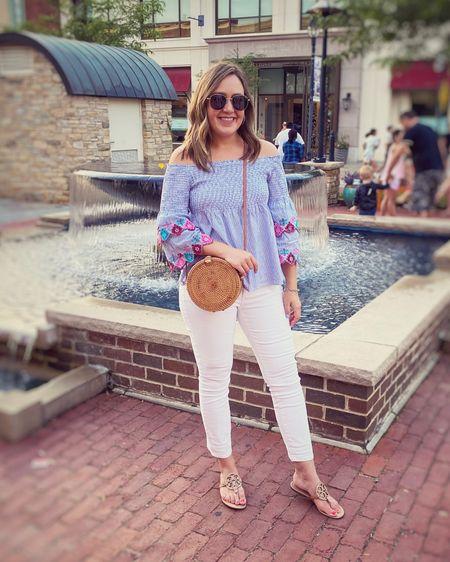 Off shoulder top. Blue stripe. Summer style. Summer outfit. White jeans. White pants. Round Rattan bag. Straw bag. Sandals. Tory Burch. http://liketk.it/3jvki #liketkit @liketoknow.it #LTKunder50 #LTKshoecrush #LTKunder100
