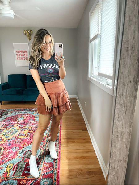 Weekend outfit ideas! A graphic tee with a cute skirt and booties! This skirt is free people and only $22! Linked all of my favorite affordable graphic ts and linked these white booties!   #LTKshoecrush #LTKsalealert #LTKstyletip