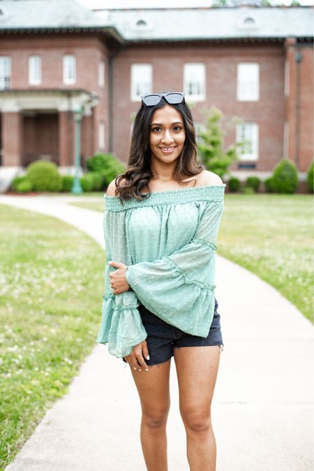 Amazon fashion outfit idea! Pretty bell sleeves and denim shorts! Wearing size small in the KIRUNDO Women's Tops Summer Chiffon Off The Shoulder Tops Swiss Dot 3/4 Bell Sleeves Casual Blouse Cute Ruffle Tunic Top!   #LTKstyletip #LTKunder50 #LTKunder100