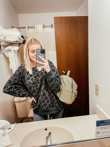 messy hotel mirror still doesn't take away from how amazing this leopard print sweatshirt is!!   #LTKstyletip #LTKunder50 #LTKsalealert