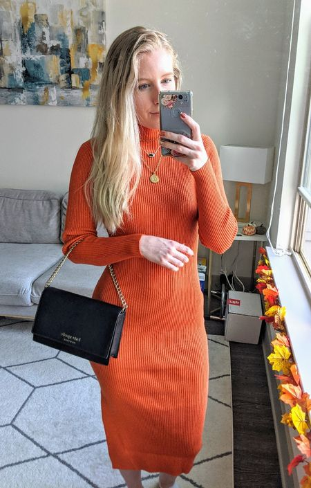 Add this beautiful rust orange Amazon sweater dress to your fall wardrobe! I paired this high neck dress with layered gold necklaces and a black purse create this easy fall look. 🍁 This dress would be perfect for a fall wedding guest!   #LTKSeasonal #LTKstyletip #LTKunder50